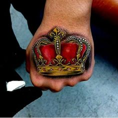 This tattoo has no any hidden meaning than royalty. The classy crown with the deep red and golden colors makes it one of the top crown tattoo ideas. It will look elegant at the back of the hand so that everyone can see it. Crown Tattoo On Wrist, Simple Crown Tattoo, King Crown Tattoo, Crown Tattoo Design, Crown Tattoos, Best Neck Tattoos, Old Tattoos, Tatoos, Thigh Tattoos