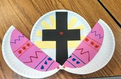 Easter Cross Craft for Children It's hard to avoid Easter eggs and the like, at Easter time. With this simple craft you can illustrate the real meaning behind Easter to your children. What you will need: 2 Paper Plates Black Paper Yellow Paper 2 craft pins Paper and pencils to decorate an easter egg Scissors