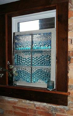 Create a privacy cover using a repurposed window and glass beads! Great for a bathroom!