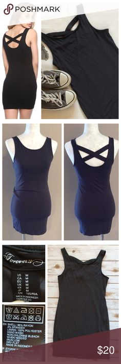 """Criss-cross back dress Dark grey body-con dress with flattering criss-cross back detailing. Designed to be fitted but fully lined for smooth finish. Exterior is soft rayon/spandex blend. Super cute dress to wear casual or with heels and a jacket. Size M, Measurements when laying flat: 14"""" chest and 29.5"""" total length. Excellent condition. Forever 21 Dresses"""