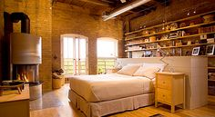 Great loft bedroom space w/ bed in middle of room to gain storage and display