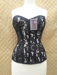 572437876b5 This romantic black lace corset features a sweetheart neckline