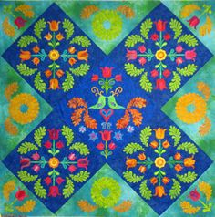 http://www.patsythompsondesigns.com/blog/index.php/archives/3630      tulip-quilt-corners-fused