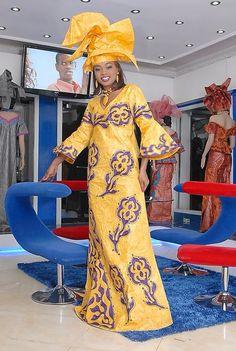 Orange maxi dress with purple embroidery by NewAfricanDesigns African Maxi Dresses, African Dresses For Women, African Women, African Clothes, African Wedding Attire, African Attire, African Wear, African Print Fashion, Africa Fashion