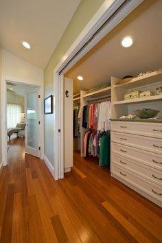 Love this idea! Use barn doors, like on the bathroom door, make one large walk-in closet, with my makeup vanity tucked in on the right side (hallway), and the slide or stairs to the basement inside of the closet.