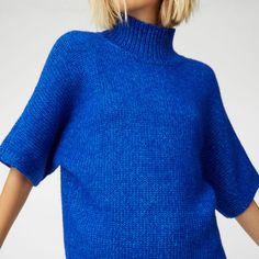 """Into the blue. Bold cobalt gives the Madhup a vibrant edge that brightens up cool autumn days. Cotton blend   Relaxed fit 23"""" in length, based on a size M Mock neck; short sleeve; rib knit trim at neck and hem  Dry clean  Imported"""