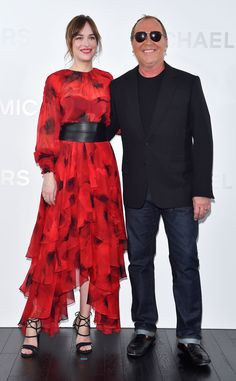 Dakota Johnson & Michael Kors from The Big Picture: Today's Hot Pics Fifty shades of fashion: The actress and designer attend the opening of Michael Kors Ginza flagship store in Tokyo.