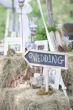 We will chalk it up and use reclaimed wood. Easy and versatile. Can be re used after the event for birthday celebrations or as garden signage.