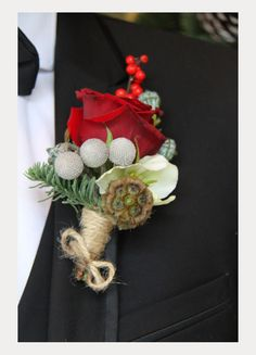 Red rose, scabiosa pod, brunia balls, pine and red berries with jute wrapped stem