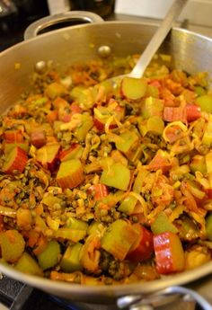 Making Rhubarb and lentil curry