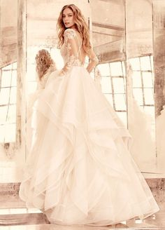 Bridal Gowns, Wedding Dresses by Hayley Paige Elysia Ivory long sleeve lace bridal ball gown, V-front bateau illusion neckline, keyhole back with piping accent, cascading tulle skirt with thin double horsehair edging. 2016 Wedding Dresses, Designer Wedding Dresses, Bridal Dresses, Wedding Gowns, Lace Wedding, Dresses 2016, Trendy Wedding, Elegant Wedding, Backless Wedding