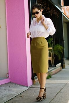 I love everything about it.  Especially the see-through blouse paired with a bandeau.  The sexy but demure pencil skirt in an odd color makes it interesting.  And those leopard print pumps?!  To DIE for.  Gahhh!!!! @Karla Pruitt Deras