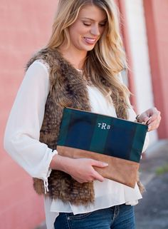 This monogrammed navy plaid makeup bag, trimmed in tan faux leather, makes a beautiful gift for brides, bridesmaids, shower hostesses, or any occasion that calls for a special, personalized gift!  Product details:  11.75 L x .75 W x 9 H Polyester with Leather-like Trim Zipper Closure Inside Lining Gold Toned Accents 0.8 Tiny Block Monogram Will Appear 1 Below the Top of the Pouch  The monogram font shown in the photo is our new tiny block font. We also offer a variety of other fonts and…