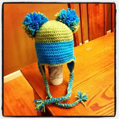 Pom Pom hat. only $13! so cute. crochet.