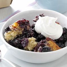 "Black and Blue Cobbler Recipe -It never occurred to me that I could bake a cobbler in my slow cooker until I saw some recipes and decided to try my favorite fruity dessert recipe. It took a bit of experimenting, but the tasty results are ""berry"" well worth it. -Martha Creveling, Orlando, Florida"
