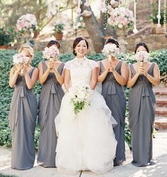 Bridesmaids with small light pink bouquets ferris wheel