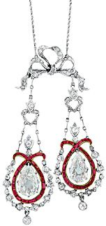"A Belle Époque 18"" long platinum, gold, diamond, and ruby lavaliere, circa 1905, of stylized garland motif, suspending two old-mine-cut pear-shaped diamonds (K-VS, with large open culets) weighing approximately 2.50 carats, framed by rubies, set throughout with small old-mine-cut and rose-cut diamonds, weighing approximately 10.5 dwt., sold for $21,250 (est. $6000/8000). Doyle New York."