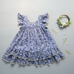 Let your little girl frolic freely in our flouncy Prairie Dress! Featuring a slight bohemian look, this design was inspired by my little girl June, who loves to twirl in full, fluffy dresses. Generous