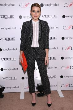 "Emma Roberts attends the Vogue Eyewear and CFDA unveiling of the ""Emma"" sunglass on October 18, 2012 in New York City wearing a Nanette Lepore suit."