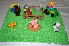 Farm yard cake; The toys were brought to me by the customer.  I made the hay, corn, and mud with icing.