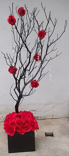 CENTERPIECES - The box and tree are provided by our florist (SweetPea). Add red roses to the base. Dangling crystals are included.
