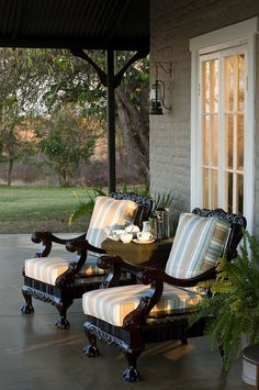 Patio Furniture: Love these chairs for the front porch. How cool to find a couple old chairs, paint them and put cushions on them. Outdoor Rooms, Outdoor Living, Outdoor Chairs, Outdoor Cushions, Adirondack Chairs, Outdoor Decor, Gazebos, Home Porch, Outside Living