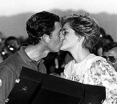 pHOTOS OF THE ISLAND WHERE PRINCESS dIANA IS BURIED | Prince Charles and PrincessDiana kiss after a polo match in Oman
