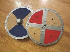 Relentlessly Fun, Deceptively Educational: Viking Shield [upcycled history craft] Sonlight Core A week 5 Escudo Viking, Dragon Birthday Parties, Dragon Party, Viking Party, Kids Viking Costume, Viking Shield, Viking Warrior, Viking Woman, Female Viking