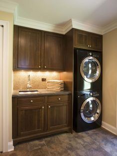 Laundry room design for smaller spaces. An excellent use of the space. Full-size stackable washer and dryer leave room for a counter, sink, and cabinets.