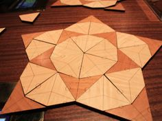 "13. This is the second Penrose Tiling, made up of ""kites"" and ""darts,""  both related to the geometry of the pentagon."