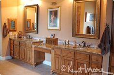 Vanity feet, separate mirrors Custom Bath Cabinets By Kent Moore Cabinets.  Rustic Hickory Wood with Golden Nutmeg Finish