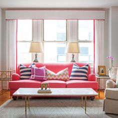 pink banding on the pelmet & curtains ties this living area together