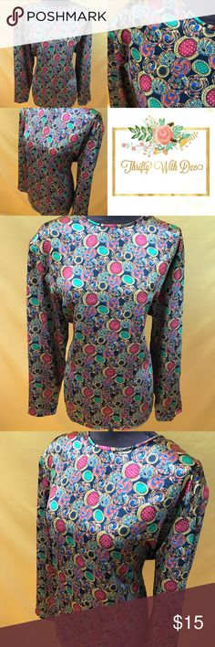 """Vintage like multi colored silk like Blouse Multi Colored """"Silk"""" Blouse --- Shoulder to Shoulder 16"""" Pit to Pit 23"""" Sleeve (neck to sleeve bottom) 29"""" Pit to Hem 16"""" --- Tag Size 16 --- 100% Polyester -- Tops Blouses"""