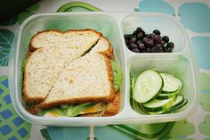 Sandwich, dried cranberries, and cucumber slices. Featuring an eco-friendly lunch box; aka Bento Box (1) From: Sophisti She, please visit
