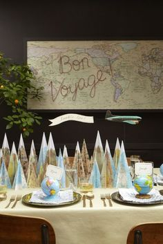 "Bon Voyage Party -- A vintage toy plane (also found on Etsy) soared above pulling a flag reading ""Toodle-loo! David spray mounted a map to foamcore, framed it, and spelled out ""Bon Voyage"" with map tacks. Seen on Martha Stewart Living. Leaving Party, Bon Voyage Party, Party Mottos, Goodbye Party, Going Away Parties, Farewell Parties, Map Globe, Travel Party, Thinking Day"