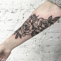 Simple and beautiful floral sleeve tattoo. Even though it lacks bright and sunny colors, it tries to cope up with the simplicity and the neatness that the design has. It also brings a fresh look into the tattoo.