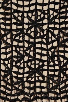 @Jennifer Mckee - This looks like Alper's lace. Oscar de la Renta  Crocheted silk and plissé-chiffon dress