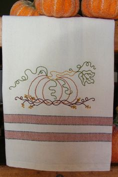 Picture of Freebie - Pumpkin 'n Vines Tea Towel...type free in the search box, and there are a ton of free embroidery designs.... enough to do a year of towels, plus...