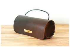 The Leather Tube is the perfect cylindrical purse for the successful artist who wants a fine leather cross-body bag to carry her brushes in. Of