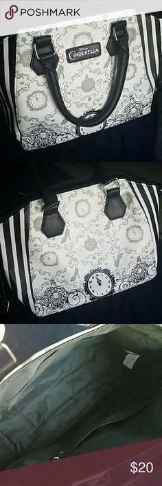 Hot Topic Cinderella purse Black and white purse with symbols that represent Disneys Cinderella. From Hot Topic. Used once for the premiere of Cinderella. Hot Topic Bags Shoulder Bags
