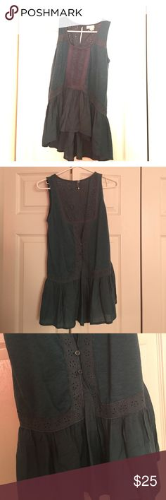 Free People top Free people ruffled top.  Teal/blue color. High low hem. Very cute on. Worn once and in excellent condition. Free People Tops