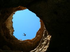 Looking up from a cave in Lagos Portugal