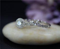 $875 Charles & Colvard Round Moissanite Ring Set Diamond Accent Solid 14K White Gold Ring Set Engagement Ring Set Wedding Ring Set Bridal  Set by NidaRings on Etsy https://www.etsy.com/listing/245377819/charles-colvard-round-moissanite-ring