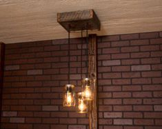 Items similar to Industrial lighting, Industrial Chandelier, Antique Brass Cage Light, Rustic Light, Reclaimed Wood and 7 Pendants. on Etsy Industrial Chandelier, Black Chandelier, Industrial Lighting, Rustic Industrial, Chandelier Lighting, Driftwood Chandelier, Ceiling Lighting, Pendant Chandelier, Pendant Lights