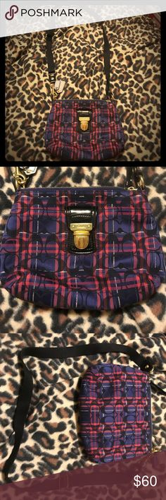 Coach mini crossbody plaid and signature C pattern Beautiful and in great condition, barely used, Coach small Crossbody bag with the signature C and navy and ref plaid pattern, gold hardware and a long adjustable black strap, very nice and very cute has sateen red lining on the inside and an outside pocket with buckle, 🚬🐱🏡smoke and animal friendly home so although items are clean you may prefer to wipe down before use💖trades only using $3 method and offers consider💖 Coach Bags Crossbody…