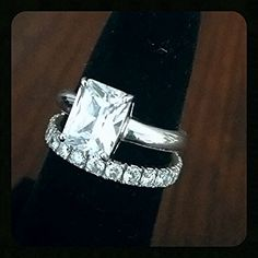 Classic Emerald Cut Desert Diamond set with an eternity band- 14k solid white gold.