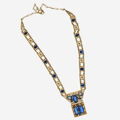 1920's Bohemian sapphire glass and fine brass filigree lavaliere necklace.
