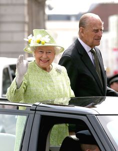 Queen Elizabeth II and Prince Philip, Duke of Edinburgh wave from the top of an open Range Rover on the monarch's 90th Birthday on April 21, 2016 in Windsor, England.