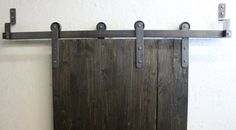 Sliding barn door hardware includes: 4 straps with 6 wheel 2 track hex lag screws 4 track stops bolts spacers 2 guide (The track does not come Cast Steel, Basement Finishing, Sliding Barn Door Hardware, Steel Wheels, Made In America, Puerto Rico, Studs, Hanger, Condo