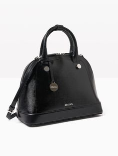 MAX&Co. - Leather rounded tote bag, Black - Leather tote bag. The model modernises a classic shape with a wide base, narrow top and rounded silhouette. To carry in the hand or across the body. Detachable and adjustable shoulder strap. Zip fastening with double slider. Studs on two sides and detachable metal charm. Protective feet. Satin lining with logo, with double open pocket and zipped pocket. Dimensions: 34�cm x 26�cm x 17�cm.A capsule collection dedicated to leather. A coherent…
